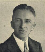 A photograph of a young man wearing a tie.