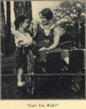 A woman in a wheelchair putting her arm around a boy.
