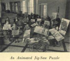 Children in wheelchairs work on a puzzle of Georgia Hall at Warm Springs.