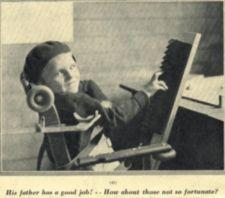 A boy sitting in a chair.