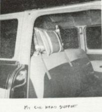 A photograph of a car seat with a homemade head support.