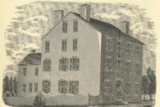 An engraving of a three-story house.