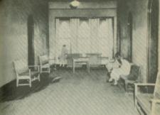 An open hall with wooden benches.