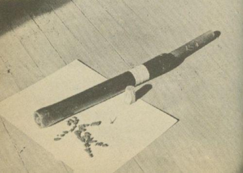 A weapon made of rubber hose laying on a table.