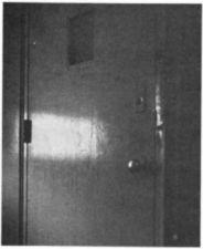 Light shining on a metal door.