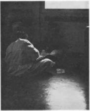 A person sitting on a floor on a ward.