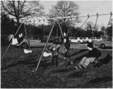 Boys on swings.