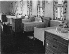 Bed and bureaus in a decorated room.