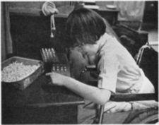 A child works with a peg board.
