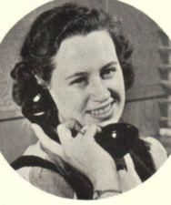 A young woman on the telephone.