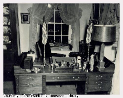 A desk with FDR momentos, including a photograph of Winston Churchill.