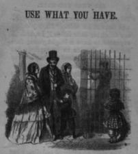 A well dressed family visits a man who is in a cage