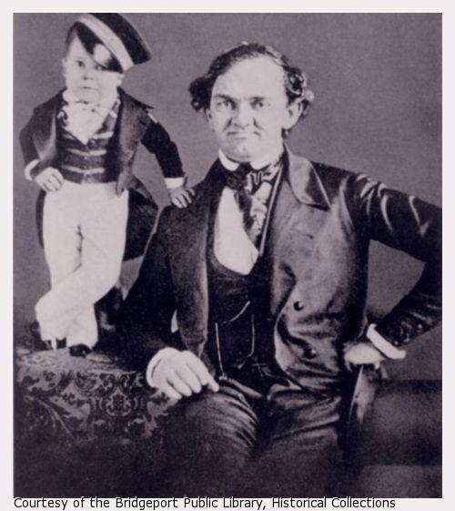 Disability history museum pt barnum with young charles stratton pt barnum sits in a chair tom thumb with hand on barnums shoulder and stopboris Choice Image