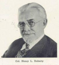 Photograph of Henry Doherty, a man with goatee and spectacles.