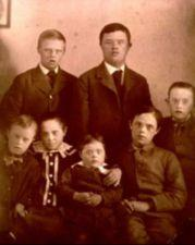 Formal portrait of seven young children with Down's Syndrome.