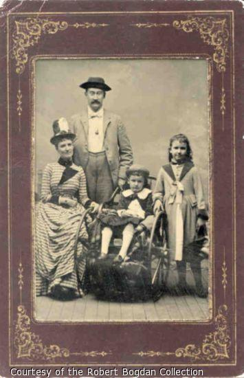 Portrait of mother, father, and two children, one in a wheelchair.