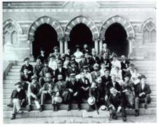 A group of men and women sit on the steps of Chapel Hall at the National Deaf-Mute College ( later renamed Gallaudet University ).