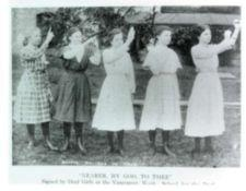 "Five young women standing on the grounds of Vancouver, Washington School for the Deaf sign the hymn ""Nearer My God, To Thee""."