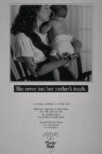 """A mother with a prosthetic arm cradles and snuggles her baby.  """"She never lost her mother's touch."""""""