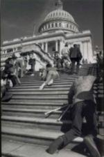 Photograph of ADA protestors crawling up Capitol Builidng steps.