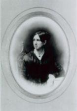 Portrait of Dorothea Dix: half-length, full face, seated, head to left, arm resting on table.