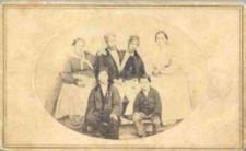 A portrait of Chang and Eng with their wives and two children.