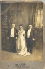 Three short-statured people, including Lavinia Warren, dressed formally.