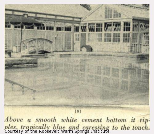 A swimming pool with an umbrella and glassed building in the background.