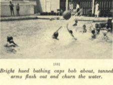 Boys play in a pool with a large ball.