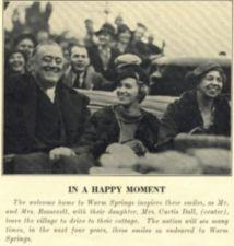 Franklin Roosevelt sits in a car with his wife and his daughter.