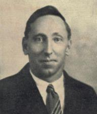 A photograph of a young man in a tie.