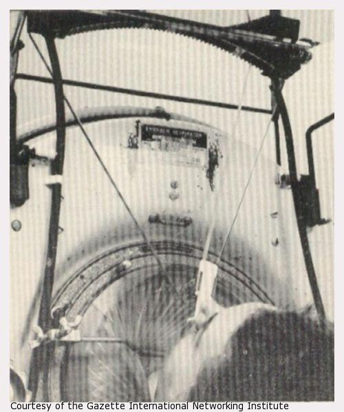 A woman types from an iron lung using her tongue.