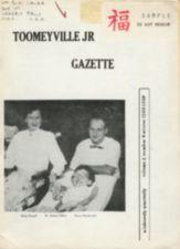 Magazine cover, with smiling man, woman, and girl.