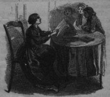 Woman sitting in chair at table reading book to three girls