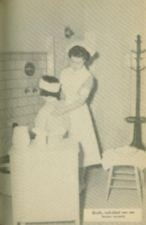 A nurse dressed in white washes a woman's back.