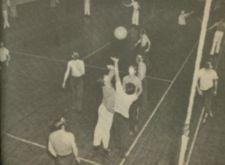 Young men playing volleyball.