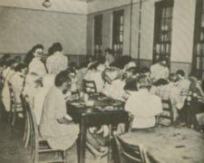 Children crowded around dining tables.