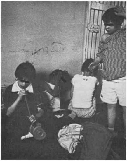 Four children in a dilapidated room.