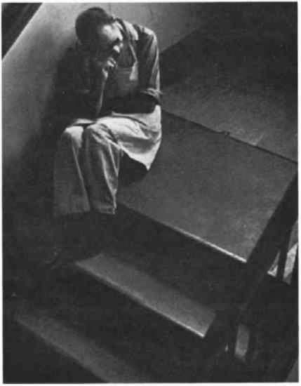 A man sitting on stairs.
