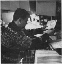 A man sorting envelopes.