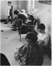 People sitting in a hall.