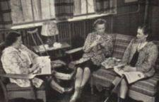 Three women sits and talk. One has a crutch and braces. Another has a cane.