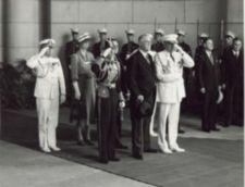 King George, Franklin Roosevelt, Eleanor Roosevelt stand with military personnel, many saluting, at Union Station.
