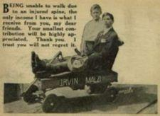 Photograph of young man sitting in a wagon with boy standing behind him