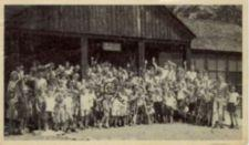 "Group photograph of campers waving.  One child is circled in pen and labelled ""Me."""