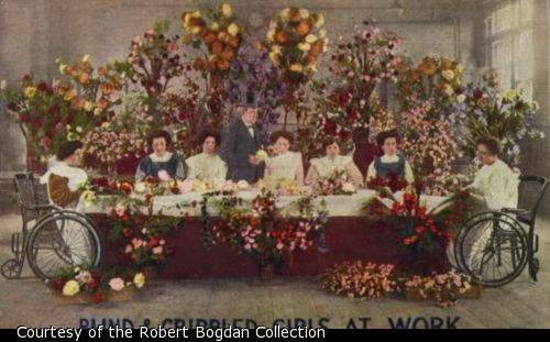 Color illustration shows seated women making flower arrangements at a long table.