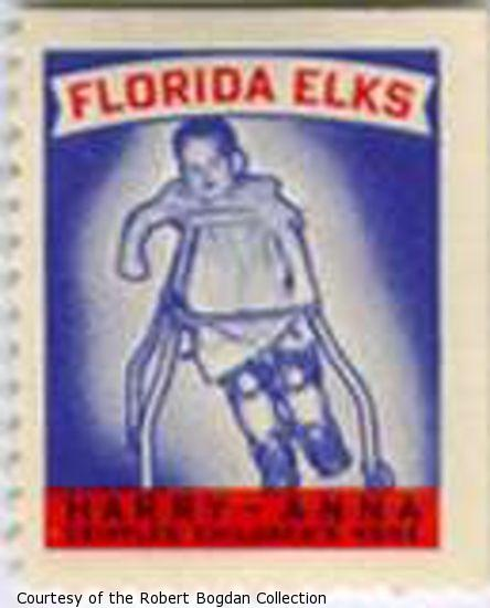 Stamp showing an infant using braces and a walker.