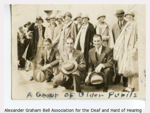 "Description handwritten on group photograph of men and women both kneeling and standing reads: ""Group of Older Pupils."""