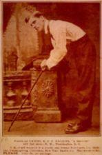 Sepia toned photo of man hunched over holding a cane.