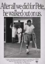 A young boy walks out of a hospital entrance way as a doctor and nurse wave good-bye.